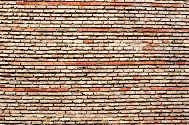 The texture of old bricks together with cement.