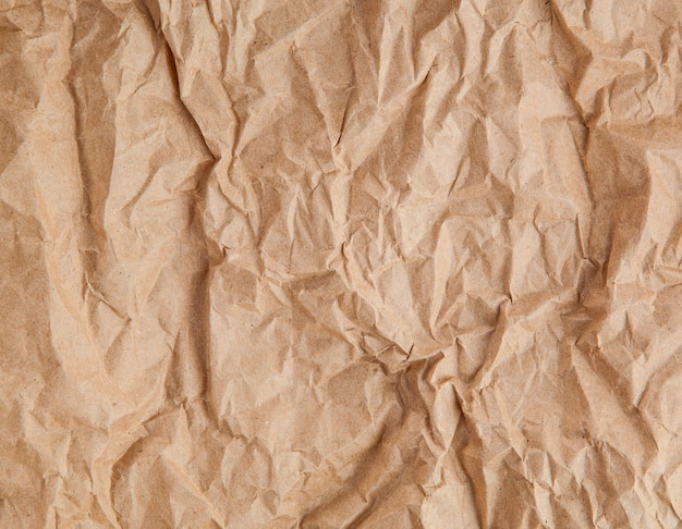 Texture of old brown crumpled paper
