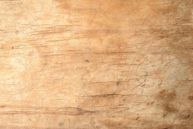Texture of a old brown wooden cutting board, full frame, backdrop for the designer, close up