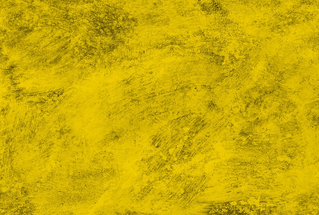 Texture of old concrete yellow wall.