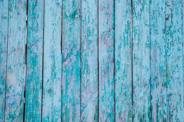 Texture of old cracked blue wooden boards background