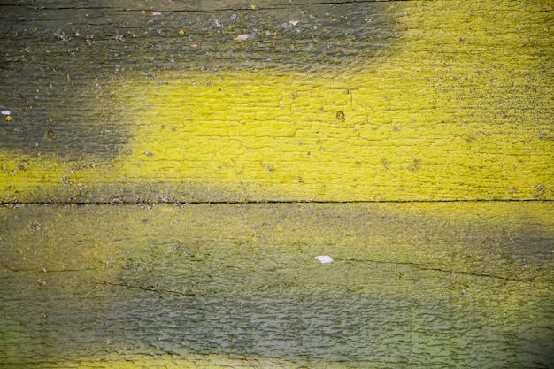 Texture of old cracked paint on wooden boards.