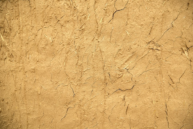 Texture of an old cracked sand wall background.