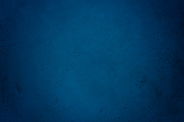 Texture of old dark blue concrete wall for background