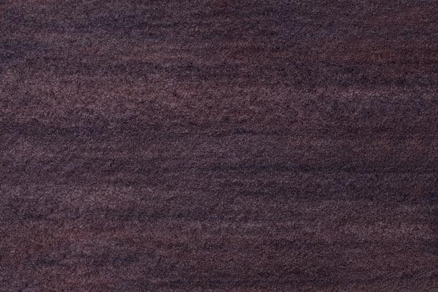 Texture of old dark brown art painting with watercolor paper, macro.