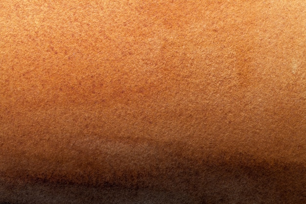 Texture of old dark brown paper closeup. structure of orange cardboard. abstract art background ginger color.