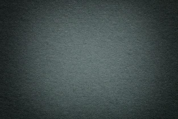 Texture of old dark green paper background