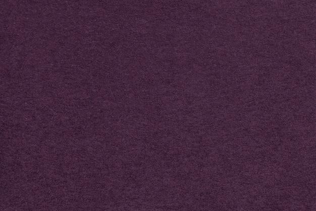 Texture of old dark purple paper closeup.