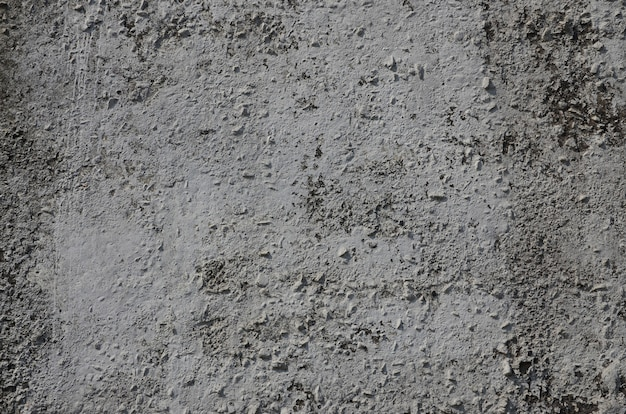 Texture of the old embossed concrete wall in gray color. background image of a concrete product