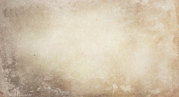 Texture of old faded light beige paper with a copy of the space
