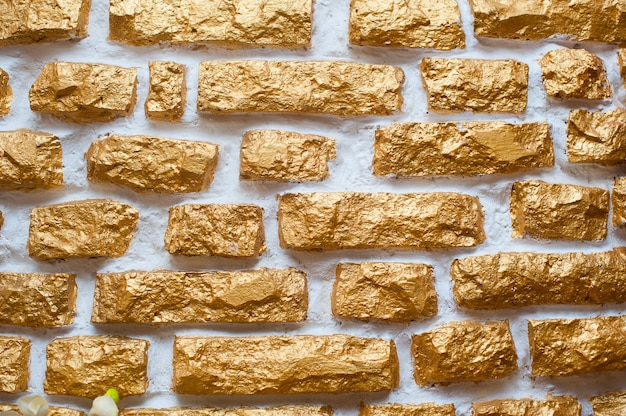 Texture of old gilded wall ornamental stone