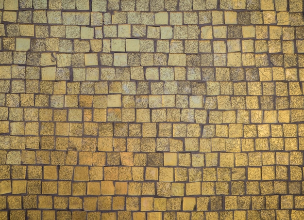 Texture of old gold stone tiles.