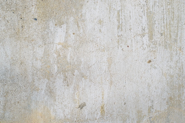Texture of old gray concrete wall outside, close-up