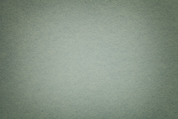 Texture of old gray paper background, closeup. structure of dense cardboard.