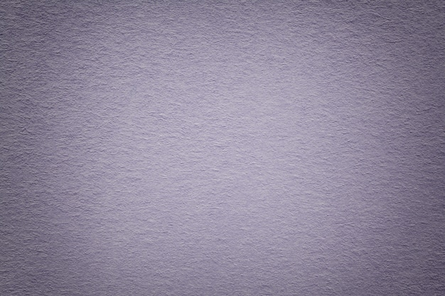 Texture of old gray paper background, closeup.