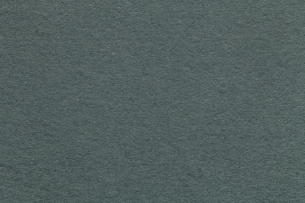 Texture of old green paper background, closeup. structure of dense gray cardboard