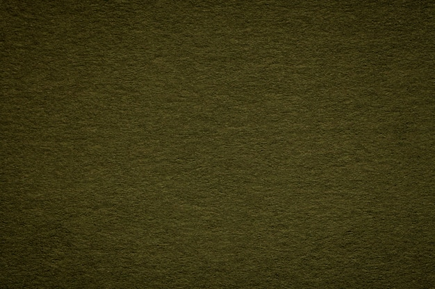 Texture of old green paper closeup, structure of a dense cardboard, the black background ,