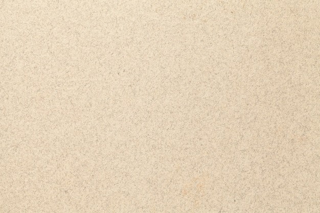 Texture of old light beige paper backdrop, closeup