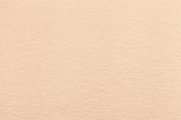 Texture of old light beige paper background.