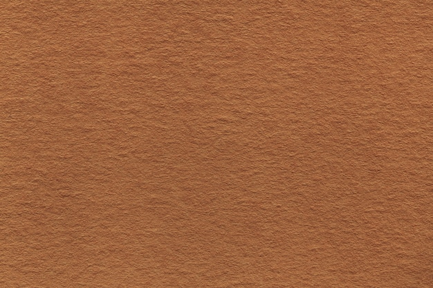 Texture of old light brown paper closeup.