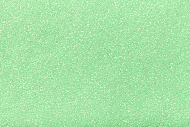 Texture of old light green paper  structure of a dense cardboard, the olive background,