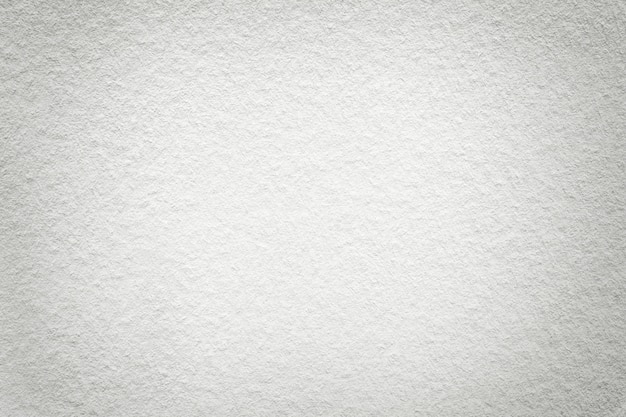 Texture of old light white paper background,  structure of dense cardboard,
