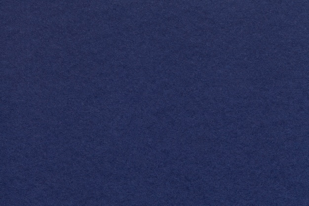 Texture of old navy blue paper closeup.