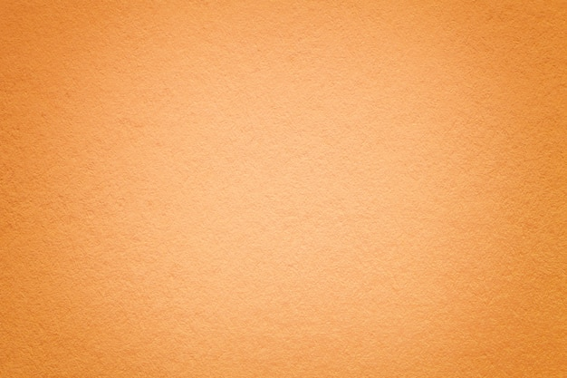 Texture of old orange paper background, closeup.