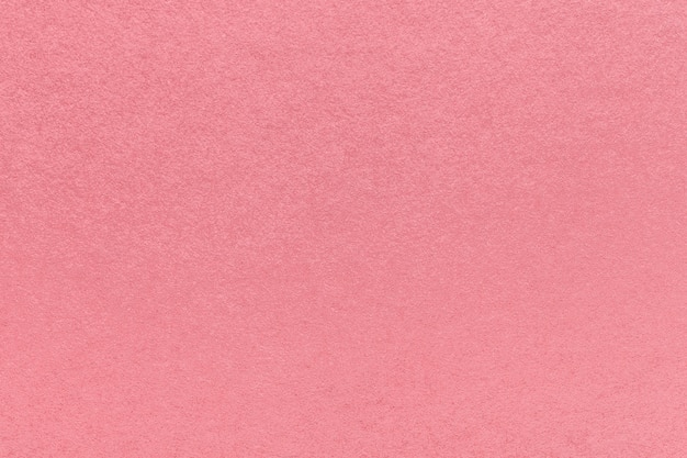 Texture of old pink paper background, closeup. structure of dense rose cardboard.