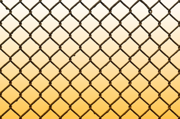 Texture of an old and rusty metal mesh on a neutral colored