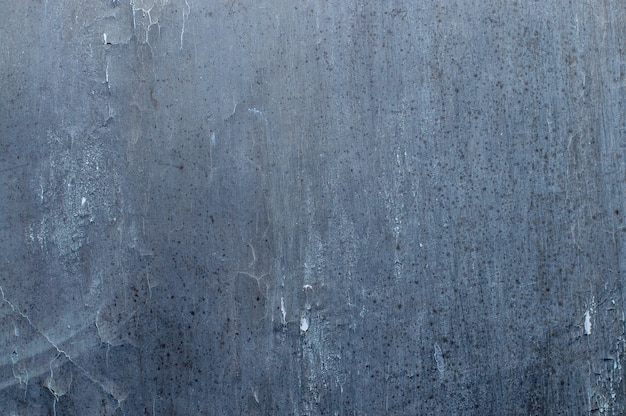 Texture of an old wall in a dark shade of color