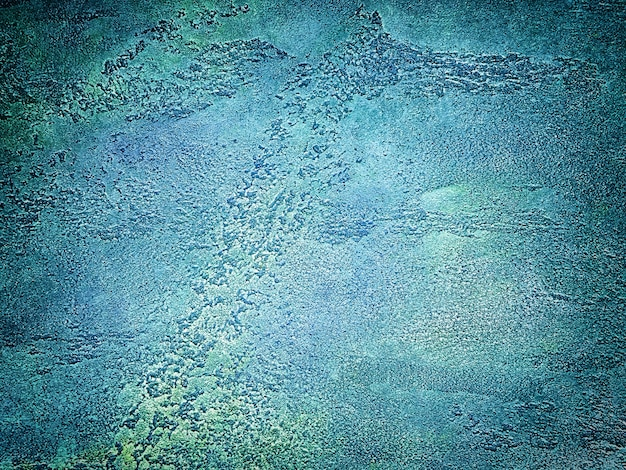 Texture of old wall with decorative plaster blue and green colors