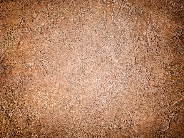 Texture of old wall with decorative plaster brown colors.
