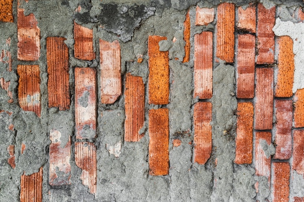 Texture of old wall with red brick close up
