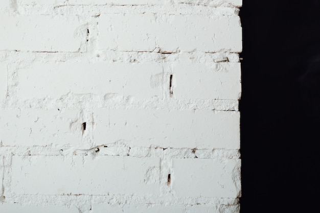 Texture of an old white and black brick wall. abstract vintage background