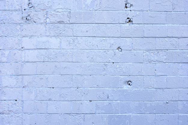 Texture of old white and gray brick wall surface background