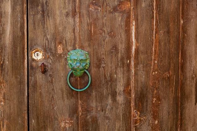 Texture of an old wooden wooden door with metal handles i