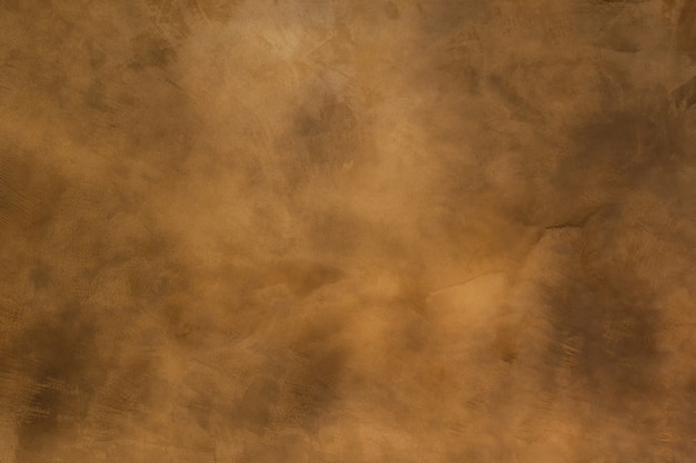 Texture of a orange brown concrete as a background, brown grungy wall