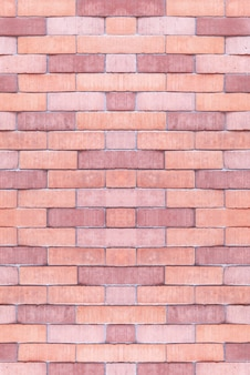 背景のテクスチャオレンジコンクリート壁