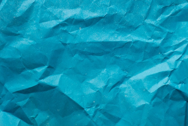 Texture of parchment mashed paper. blue background