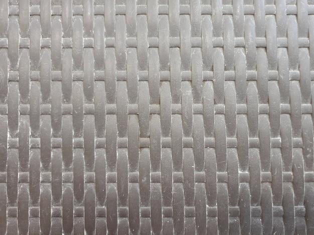 黒織りプラスチック背景のテクスチャパターン
