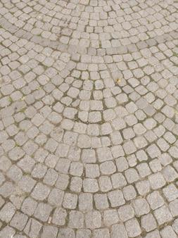 Фактура, узор из легкой тротуарной плитки, тротуар, выложенный полукругом