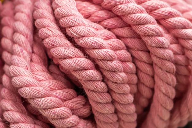 Texture of pink fluffy woolen threads for knitting closeup.