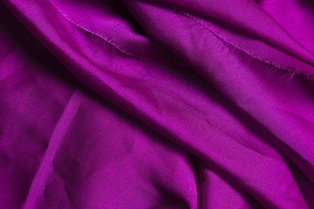 Texture of purple crumpled fabric