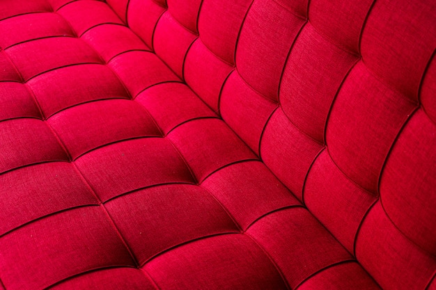 Texture of red cloth sofa.
