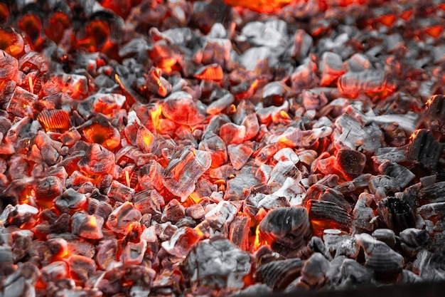 Texture red hot coals, selective focus. barbecue grill dark background
