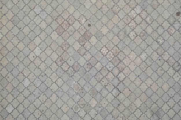 The texture of a rhythmic mosaic made of concrete tiles