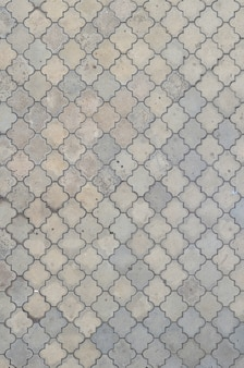 The texture of a rhythmic mosaic made of concrete tiles.