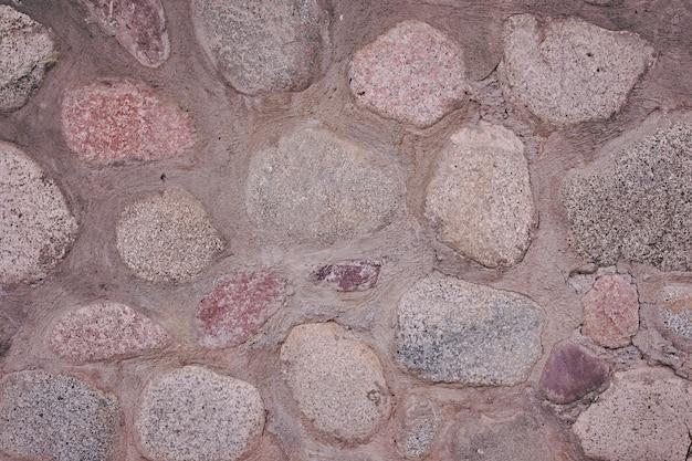 질감 바위 벽입니다. 오래 된 성 잔해 벽 질감 배경입니다.