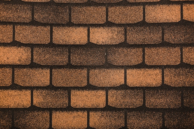 Texture of the roof of flexible roof tiles, close-up photo